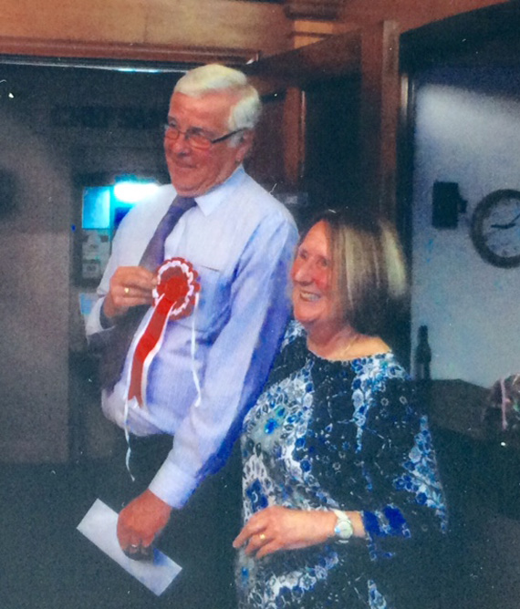 This years winner Geoff Mullins receiving his prize and rosette from Sue Hull
