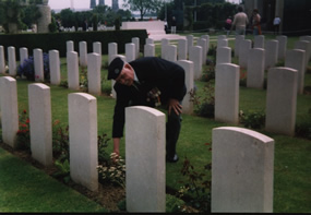 Len Butt Laying a wreath on the Grave of Sgt J.A.Brown R.E.