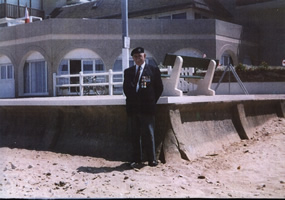 Len Butt standing at the approximate spot where he had Landed on D-Day